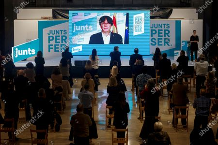 Former Catalan President Carles Puigdemont (C) receives a round of applause as he attends via video conference a campaign rally of pro-independence party Junts per Catalunya (JxCat) held in Tarragona, Spain, 11 February 2021. Spanish state of Catalonia will hold regional elections on the upcoming 14 February.