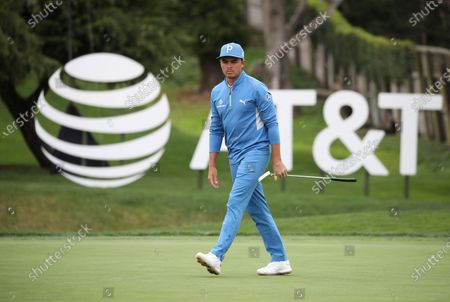 Rickie Fowler of the USA walks to his ball on the 16th green during the first round of the Pebble Beach Pro-Am golf tournament at Pebble Beach Golf Links in Pebble Beach, California, USA, 11 February 2021. The event in 2021 features only professional golfers due to COVID-19 restrictions.