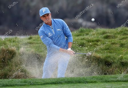 Rickie Fowler of the US hits a bunker shot on the 17th hole during the first round of the Pebble Beach Pro-Am golf tournament at Pebble Beach Golf Links in Pebble Beach, California, USA, 11 February 2021. The event in 2021 features only professional golfers due to Covid-19 restrictions.
