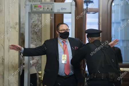 Jason Miller, advisor to former US President Donald Trump, is wanded by Capitol police upon arrival on the third of the second impeachment trial at the Capitol in Washington, DC on Thursday, February 11, 2021. Arguments will be presented in the impeachment trial of former President Donald Trump today.  Pool Photo by Michael ReynoldsUPI