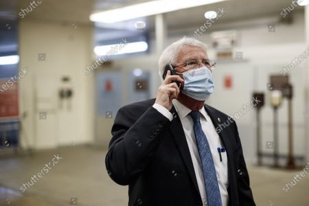 Senator Roger Wicker, a Republican from Mississippi, wears a protective mask while walking through the Senate Subway at the U.S. Capitol on the third day of the second impeachment trial at the Capitol in Washington, DC on Thursday, February 11, 2021. Arguments will be presented in the impeachment trial of former President Donald Trump today.