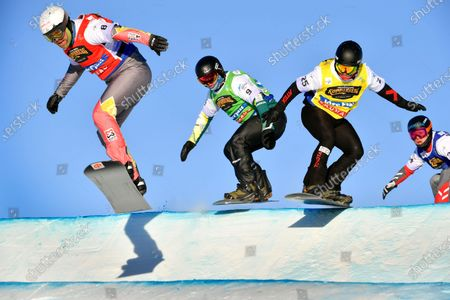Stock Photo of Martin Noerl, Germany, red, Adam Lambert, Australia, green, Jan Kubicik, Czech Republic, yellow and Shinya Momono, Japan, blue during the men's 1/8 final at the FIS Snowboard Cross World Championships in Idre, Sweden, on Feb. 11, 2021. To the left Eliot Grondin, Canada, who placed third.