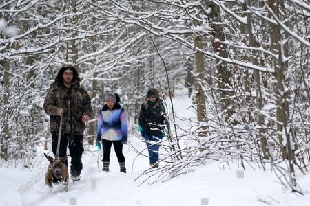 Will Wilson, left, follows his pit bull Loki while hiking with Jennifer Long, center, and Ashley Walton at Oregon Ridge Park, in Cockeysville, Md