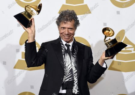 "Stock Image of Chick Corea poses in the press room with the awards for best improvised jazz solo for ""Fingerprints"" and best jazz instrumental album for ""Trilogy"" at the 57th annual Grammy Awards on Feb. 8, 2015, in Los Angeles. Corea, a towering jazz pianist with a staggering 23 Grammy awards who pushed the boundaries of the genre and worked alongside Miles Davis and Herbie Hancock, has died. He was 79. Corea died, of a rare for of cancer, his team posted on his web site. His death was confirmed by Corea's web and marketing manager, Dan Muse"