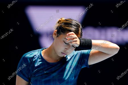 Zarina Diyas of Kazakhstan reacts while in action against Garbine Muguruza of Spain during their third round match of the Australian Open grand slam tennis tournament at Melbourne Park in Melbourne, Australia, 12 February 2021.