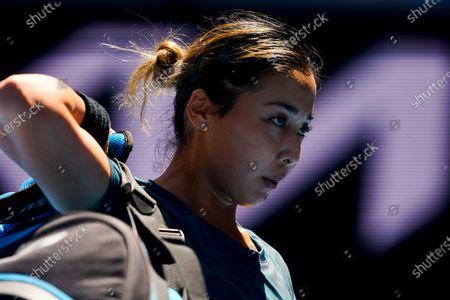 Zarina Diyas of Kazakhstan walks off the court after loosing against Garbine Muguruza of Spain during their third round match of the Australian Open grand slam tennis tournament at Melbourne Park in Melbourne, Australia, 12 February 2021.
