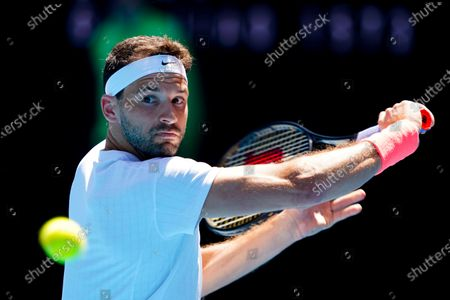 Grigor Dimitrov of Bulgaria in action against Pablo Carreno Busta of Spain during their third round match of the Australian Open grand slam tennis tournament at Melbourne Park in Melbourne, Australia, 12 February 2021.