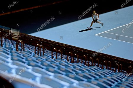 A view of empty spectators stands as Alexander Zverev of Germany plays during his third Round Men's singles match against Adrian Mannarino of France on Day 5 of the Australian Open tennis tournament at Melbourne Park in Melbourne, Victoria, Australia, 12 February 2021. The Australian Open is set to proceed without crowds after Victoria was sent into a five-day lockdown after a surge of coronavirus disease (COVID-19) cases in Melbourne.