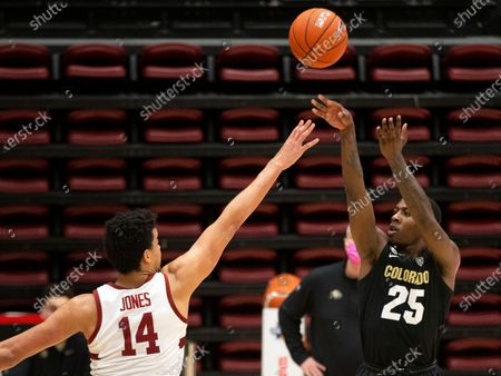 Colorado guard McKinley Wright IV (25) shoots over Stanford forward Spencer Jones (14) during the second half of an NCAA college basketball game, in Stanford, Calif. Colorado won 69-51