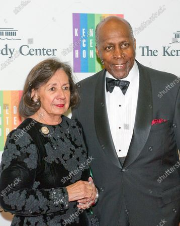 Vernon Jordan and his wife, Ann, arrive for the formal Artist's Dinner honoring the recipients of the 2013 Kennedy Center Honors hosted by United States Secretary of State John F. Kerry at the U.S. Department of State in Washington, D.C.. The 2013 honorees are: opera singer Martina Arroyo; pianist, keyboardist, bandleader and composer Herbie Hancock; pianist, singer and songwriter Billy Joel; actress Shirley MacLaine; and musician and songwriter Carlos Santana.