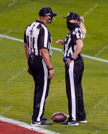 Referee Carl Cheffers talks with Down Judge Sarah Thomas during the NFL Super Bowl 55 football game, in Tampa, Fla