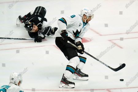 San Jose Sharks left wing Evander Kane (9) gets control of the puck from Los Angeles Kings defenseman Drew Doughty (8) during the first period of an NHL hockey game, in Los Angeles