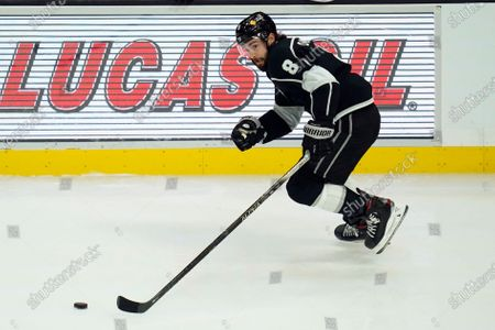 Los Angeles Kings defenseman Drew Doughty (8) controls the puck during the first period of the team's NHL hockey game against the San Jose Sharks, in Los Angeles