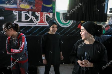 Manizha Talash (R), an 18-year-old Afghan girl, takes a break during a break dancing class in Kabul, Afghanistan, 05 February 2021 (issued 12 February 2021). A group of young Afghan boys and girls founded a Breaking (breakdance) club a year ago in Kabul, braving all social and security challenges and threats to professionally promote breakdancing in Afghanistan. The club has 40 members, of whom six are female, and gather three times a week to practice the acrobatic moves, including headspins, that are hallmarks of breaking dancing. Based on the Afghan social norms and conservative culture, girls are strongly prohibited to do sport with men, but some girls dared to join the Breaking club. Breaking also called breakdance, B-Boying, or B-Girling is a style of street dance, invented in the 1970s in the United States, was among four sports, along with skateboarding, sports climbing, and surfing, that the International Olympic Committee agreed recently to add to the Paris Games in 2024, in an effort to attract a younger, more urban audience.