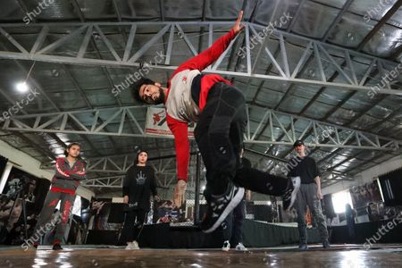Tamim Sabri practices break dancing during a training session in Kabul, Afghanistan, 05 February 2021 (issued 12 February 2021). A group of young Afghan boys and girls founded a Breaking (breakdance) club a year ago in Kabul, braving all social and security challenges and threats to professionally promote breakdancing in Afghanistan. The club has 40 members, of whom six are female, and gather three times a week to practice the acrobatic moves, including headspins, that are hallmarks of breaking dancing. Based on the Afghan social norms and conservative culture, girls are strongly prohibited to do sport with men, but some girls dared to join the Breaking club. Breaking also called breakdance, B-Boying, or B-Girling is a style of street dance, invented in the 1970s in the United States, was among four sports, along with skateboarding, sports climbing, and surfing, that the International Olympic Committee agreed recently to add to the Paris Games in 2024, in an effort to attract a younger, more urban audience.