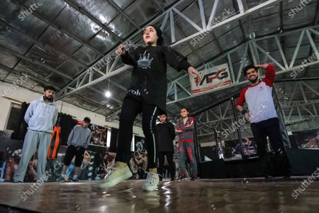 Manizha Talash (C), a 18-year-old Afghan girl, practices break dancing during a training session in Kabul, Afghanistan, 05 February 2021 (issued 12 February 2021). A group of young Afghan boys and girls founded a Breaking (breakdance) club a year ago in Kabul, braving all social and security challenges and threats to professionally promote breakdancing in Afghanistan. The club has 40 members, of whom six are female, and gather three times a week to practice the acrobatic moves, including headspins, that are hallmarks of breaking dancing. Based on the Afghan social norms and conservative culture, girls are strongly prohibited to do sport with men, but some girls dared to join the Breaking club. Breaking also called breakdance, B-Boying, or B-Girling is a style of street dance, invented in the 1970s in the United States, was among four sports, along with skateboarding, sports climbing, and surfing, that the International Olympic Committee agreed recently to add to the Paris Games in 2024, in an effort to attract a younger, more urban audience.
