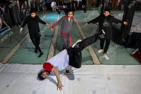 Afghan youths practices break dancing during a training session in Kabul, Afghanistan, 05 February 2021 (issued 12 February 2021). A group of young Afghan boys and girls founded a Breaking (breakdance) club a year ago in Kabul, braving all social and security challenges and threats to professionally promote breakdancing in Afghanistan. The club has 40 members, of whom six are female, and gather three times a week to practice the acrobatic moves, including headspins, that are hallmarks of breaking dancing. Based on the Afghan social norms and conservative culture, girls are strongly prohibited to do sport with men, but some girls dared to join the Breaking club. Breaking also called breakdance, B-Boying, or B-Girling is a style of street dance, invented in the 1970s in the United States, was among four sports, along with skateboarding, sports climbing, and surfing, that the International Olympic Committee agreed recently to add to the Paris Games in 2024, in an effort to attract a younger, more urban audience.