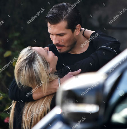Gleb Savchenko and girlfriend Cassie Scerbo share a passionate kiss... days after reports they were 'taking a break'