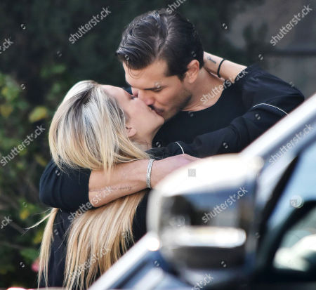 Stock Photo of Gleb Savchenko and girlfriend Cassie Scerbo share a passionate kiss... days after reports they were 'taking a break'