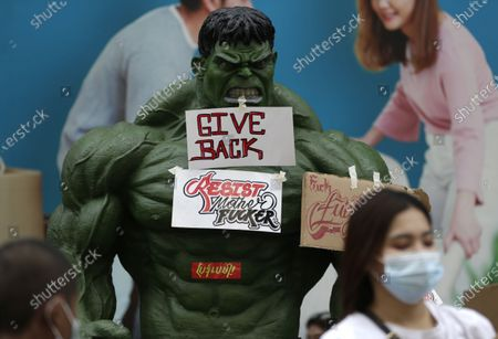 Placards hung from a sculpture of the 'Incredible Hulk' fictional character during a protest against the military coup in Yangon, Myanmar, 12 February 2021. People continued to rally across the country despite orders banning mass gatherings and reports of increasing use of force by police against anti-coup protesters. Myanmar's military seized power and declared a state of emergency for one year after arresting State Counselor Aung San Suu Kyi and Myanmar president Win Myint in an early morning raid on 01 February.
