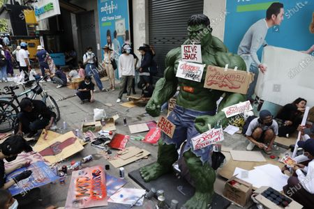 Stock Image of People making art beside a sculpture of the 'Incredible Hulk' fictional character during a protest against the military coup in Yangon, Myanmar, 12 February 2021. People continued to rally across the country despite orders banning mass gatherings and reports of increasing use of force by police against anti-coup protesters. Myanmar's military seized power and declared a state of emergency for one year after arresting State Counselor Aung San Suu Kyi and Myanmar president Win Myint in an early morning raid on 01 February.