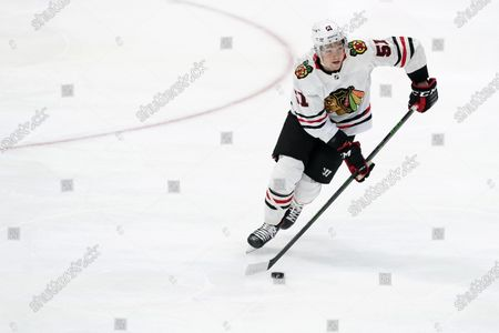 Chicago Blackhawks' Ian Mitchell advances the puck against the Dallas Stars during an NHL hockey game in Dallas