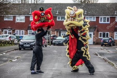 Chinese New Year: Lion Dance Instructor Matt Williams from the World Eagle Claw Association UK gives his costumes an airing in the street in Hampshire over the Chinese New Year after all his bookings and performances have been cancelled due to the current Coronavirus Lockdown during the Year of the Ox festivities.