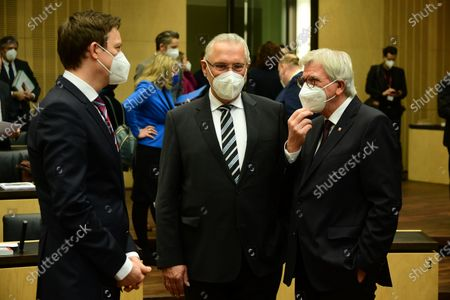 (L-R) Saarland State Premier Tobias Hans, Interior Minister of Bavaria Joachim Herrmann and Hesse State Premier Volker Bouffier wear face masks as they talk prior to the beginning of the 1,000th session of the German Federal Council (Bundesrat), in Berlin, Germany, 12 February 2021. The German Federal Council assembled for the 1,000th time. The first session was held on 07 September 1949.