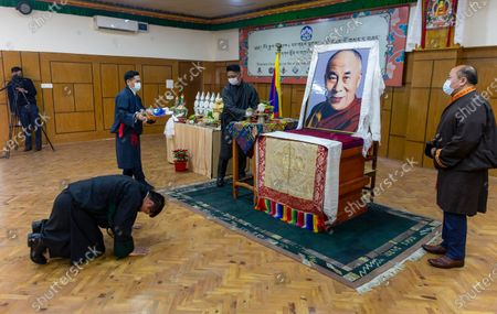 Lobsang Sangay, President of the Central Tibetan Administration, prostrates in front of a portrait of his spiritual leader the Dalai Lama at an event marking the first day of the Tibetan New Year or Losar in Dharmsala, India