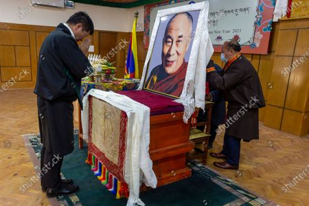 Lobsang Sangay, President of the Central Tibetan Administration, prays in front of a portrait of his spiritual leader the Dalai Lama at an event marking the first day of the Tibetan New Year or Losar in Dharmsala, India