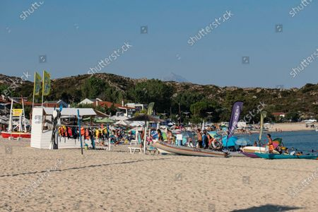 Crowd of tourists at the popular and famous beach of Kalamitsi located on the southern tip of Sithonia peninsula in Chalkidiki in Northern Greece. People have fun at the beach in Greece as they are relaxing under the shadow of the umbrellas, snorkeling, scuba diving, swimming in the tropical exotic crystal clear clean waters, doing water sports, renting boats, having a drink at the beach bars or sunbathing on the golden sand and enjoying beach life under the sunny blue sky. There is a little island also located close to the shore. The local government is adding new safety measures such as social distancing, changing the working hours, obligatory facemask usage etc against the spread of the Coronavirus Covid-19 Pandemic outbreak after relaxing the lockdown, travel and traffic ban, quarantine a few weeks ago, trying to relaunch the tourism season, but recently the number of cases began increasing in Greece, especially to locations near summer holiday destinations, resorts, beach bars, travel locations, night club party etc involving mostly tourists and younger people. The beachbars in Halkidiki infected a large number of people the previous days. August 14, 2020 - Halkidiki, Greece (Photo by Nicolas Economou/NurPhoto)