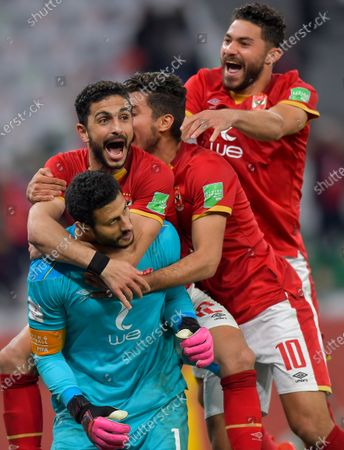 Al Ahly SC's goalkeeper Mohamed El-Shenawy (front) and teammates celebrate after winning the penalty shoot-out of the FIFA Club World Cup 3rd place match between Egypt's Al Ahly SC and Brazil's SE Palmeiras at the Education City Stadium in Doha, Qatar, Feb. 11, 2021.