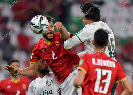 Yasser Ibrahim (L) of Al Ahly SC vies for the ball with Gustavo Gomez (R) of SE Palmeiras during the FIFA Club World Cup 3rd place match between Egypt's Al Ahly SC and Brazil's SE Palmeiras at the Education City Stadium in Doha, Qatar, Feb. 11, 2021.
