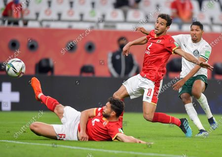 Hamdy Fathy (C) of Al Ahly SC vies for the ball with Rony (R) of SE Palmeiras during the FIFA Club World Cup 3rd place match between Egypt's Al Ahly SC and Brazil's SE Palmeiras at the Education City Stadium in Doha, Qatar, Feb. 11, 2021.