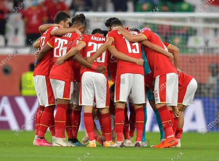 Players of Al Ahly SC gather prior to the FIFA Club World Cup 3rd place match between Egypt's Al Ahly SC and Brazil's SE Palmeiras at the Education City Stadium in Doha, Qatar, Feb. 11, 2021.