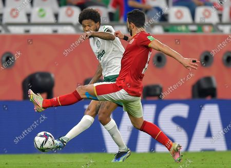 Ayman Ashraf (R) of Al Ahly SC vies for the ball with Luiz Adriano of SE Palmeiras during the FIFA Club World Cup 3rd place match between Egypt's Al Ahly SC and Brazil's SE Palmeiras at the Education City Stadium in Doha, Qatar, Feb. 11, 2021.