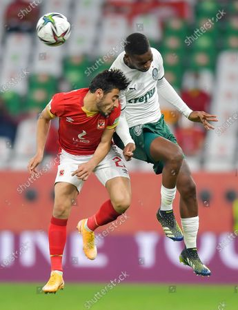 Akram Tawfik (L) of Al Ahly SC vies for a header with Patrick De Paula of SE Palmeiras during the FIFA Club World Cup 3rd place match between Egypt's Al Ahly SC and Brazil's SE Palmeiras at the Education City Stadium in Doha, Qatar, Feb. 11, 2021.