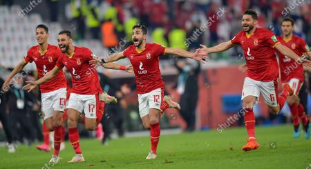Al Ahly SC's players celebrate after winning the penalty shoot-out of the FIFA Club World Cup 3rd place match between Egypt's Al Ahly SC and Brazil's SE Palmeiras at the Education City Stadium in Doha, Qatar, Feb. 11, 2021.