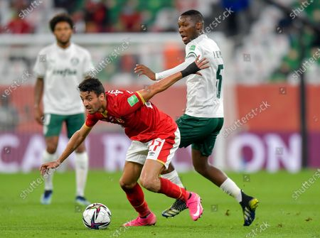 Taher Mohamed (L) of Al Ahly SC vies for the ball with Patrick De Paula of SE Palmeiras during the FIFA Club World Cup 3rd place match between Egypt's Al Ahly SC and Brazil's SE Palmeiras at the Education City Stadium in Doha, Qatar, Feb. 11, 2021.