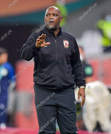 Stock Image of Head coach of Al Ahly SC Pitso Mosimane reacts during the FIFA Club World Cup 3rd place match between Egypt's Al Ahly SC and Brazil's SE Palmeiras at the Education City Stadium in Doha, Qatar, Feb. 11, 2021.