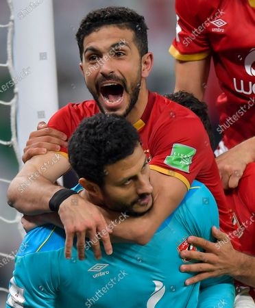 Stock Picture of Al Ahly SC's goalkeeper Mohamed El-Shenawy (below) and teammate Ayman Ashraf celebrate after winning the penalty shoot-out of the FIFA Club World Cup 3rd place match between Egypt's Al Ahly SC and Brazil's SE Palmeiras at the Education City Stadium in Doha, Qatar, Feb. 11, 2021.