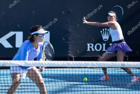 Yang Zhaoxuan (R)/Xu Yifan compete during the women's doubles second round match between Yang Zhaoxuan/Xu Yifan of China and Anna Kalinskaya of Russia/Viktoria Kuzmova of Slovakia at the Australian Open in Melbourne Park, in Melbourne, Australia, on Feb. 12, 2021.