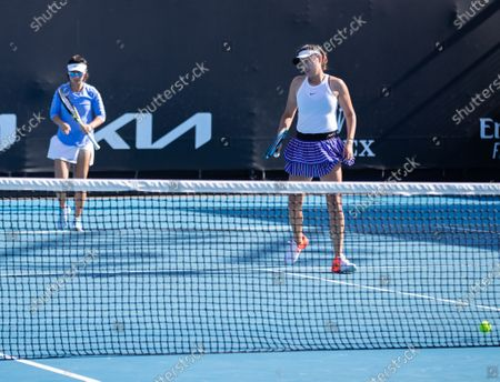 Yang Zhaoxuan (R)/Xu Yifan react during the women's doubles second round match between Yang Zhaoxuan/Xu Yifan of China and Anna Kalinskaya of Russia/Viktoria Kuzmova of Slovakia at the Australian Open in Melbourne Park, in Melbourne, Australia, on Feb. 12, 2021.