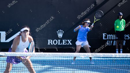 Yang Zhaoxuan(L)/Xu Yifan (C) compete during the women's doubles second round match between Yang Zhaoxuan/Xu Yifan of China and Anna Kalinskaya of Russia/Viktoria Kuzmova of Slovakia at the Australian Open in Melbourne Park, in Melbourne, Australia, on Feb. 12, 2021.