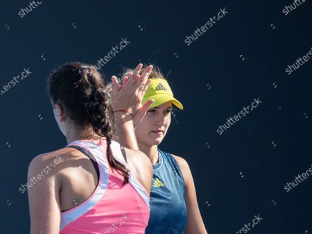 Anna Kalinskaya (R)/Viktoria Kuzmova react during the women's doubles second round match between Yang Zhaoxuan/Xu Yifan of China and Anna Kalinskaya of Russia/Viktoria Kuzmova of Slovakia at the Australian Open in Melbourne Park, in Melbourne, Australia, on Feb. 12, 2021.