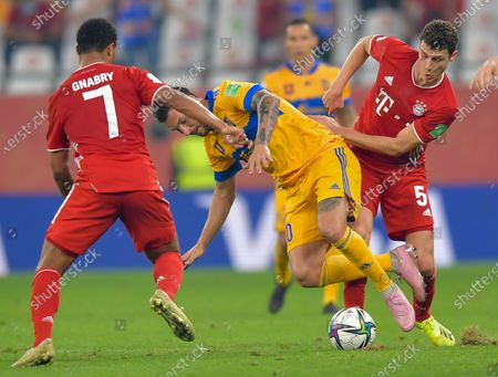 Serge Gnabry (L) and Benjamin Pavard (R) of Bayern Munich vie for the ball with Andre Pierre Gignac of Tigres Uanl during the FIFA Club World final match between Germany's Bayern Munich and Mexico's Tigres Uanl at the Education City Stadium in Doha, Qatar, Feb. 11, 2021.