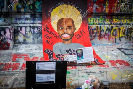 A memorial to Marcus David Peters lays against the monument in Washington DC, United States