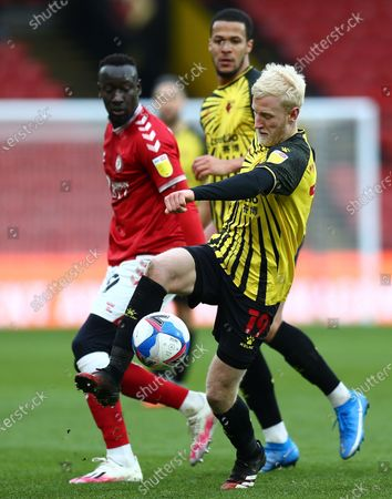 Will Hughes of Watford and Famara Diedhiou of Bristol City in action