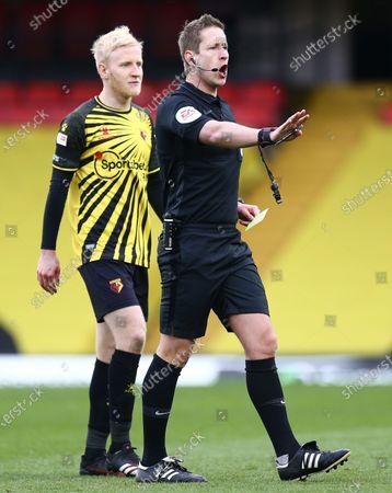 Referee John Brooks and Will Hughes of Watford