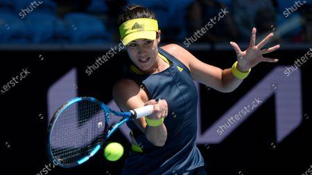 Spain's Garbine Muguruza makes a forehand return to Kazakhstan's Zarina Diyas during their third round match at the Australian Open tennis championship in Melbourne, Australia